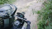 rodas : POV slow-motion shot of a rider in a crash helmet and part of a black motard motorcycle, Enduro racing through the woods during the race. Extreme entertainment on rough terrain. The concept of active recreation Stock Footage