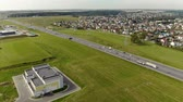 dálnice : Aerial: panorama of a busy motorway with the private sector in the background. Landscape of the outskirts of the city with a ring road in the summer