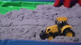 Kinetic sand. Father(adult mans hands play with toys in sand) Close-up.