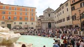 May 12, 2018, Rome, Italy. Crowd of tourists at Trevi Fountain. Tourists in Rome at Trevi Fountain. Church of Saints Vincent and Anastasius in Piazza di Trevi in Rome.