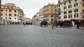 May 12, 2018, Rome, Italy. Rome, Piazza di Spagna, tourists and carriages with horses. The horse-drawn carriages in the Spanish Steps in Rome. Timelapse.