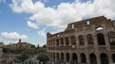 imperatore romano : June 9 2018, Rome, Italy. Crowd of tourists visiting the Colosseum in Rome. Time lapse of the Colosseum. The Colosseum and the Roman Forum. 4k. Filmati Stock