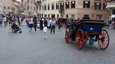 May 12, 2018, Rome, Italy. Rome, Piazza di Spagna, tourists and carriages with horses. The horse-drawn carriages in the Spanish Steps in Rome.