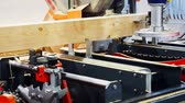 технологический : wood industries and manufacturing.running machine for cutting timber into planks.technological process.Band saw cuts the logs into boards.Close-up
