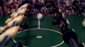 вратарь : Games, entertainment, hobbies and leisure.foosball.plastic players in the table soccer.game kicker close up.Shallow depth of field