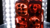 plástico : Red and transparent dice rotate on light background