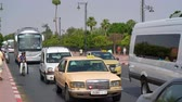 Cars and busses riding a main road in Marrakech Стоковые видеозаписи