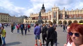 Tourists visiting the main square in the center of Krakow