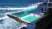Locals and tourists enjoying the pool with fresh seawater on the famous Bondi beach