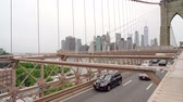 шины : Traffic leaving the Brooklyn bridge towards Brooklyn in New York