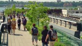 locals and tourist enjoying the Highline walkway in downtown Manhatten