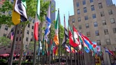 Flags of numerous nations on Rockefellar Plaza in the heart of New York City