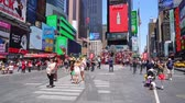 dobrador : locals and tourists walking the middle of Times Sqaure in the heart of New York City