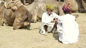 male animal : Two senior indian men at Pushkar Camel Fair in Rajasthan, India