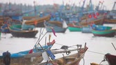 água : Colored fishing boats floating in the harbour near Mui Ne Vietnam.