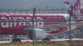 wing : AirAsia Airbus 320 taxiing Stock Footage