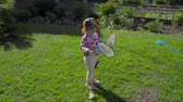 Girl with badminton rackets Stock Footage