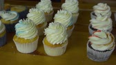 Colored cream on top of a cupcake Stock Footage