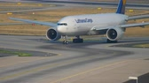 commercial : Boeing 777 taxiing after landing Stock Footage