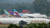phuket : Widebody airplane taxiing on apron Stock Footage