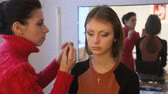 maskara : Makeup artist applies mascara.