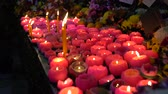 simbolismo : Lit candles at a Wesak day festival
