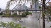 tornar : BRISBANE, AUSTRALIA - SEPTEMBER 28 2011: The iconic Story Bridge spanning the Brisbane River in Brisbane Australia with a city cat ferry. Construction of the bridge began on May 24 1935 and has now become Brisbanes greatest tourist attraction.