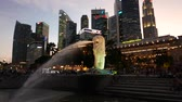 fullerton : sunset view of merlion park, singapore
