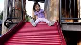 Asian chinese young child playing alone in the playground Stock Footage