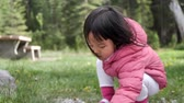 Asian Chinese Toddler and mother playing in a park