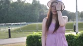 Asian chinese woman in slow motion walking on grass lawn