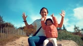 delighted : Mother and child waving their hands in slow motion Stock Footage