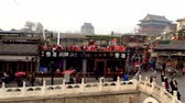food and drink : Beijing, China-March 24,2014: The panorama view near Yinding Bridge located in the Houhai Bar Street, Beijing, China