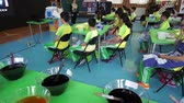 Children listening to teacher in a fabric dyeing workshop 動画素材