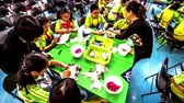 Children in a fabric dyeing workshop