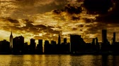 At sunset, the Manhattan skyline, New York City, NY