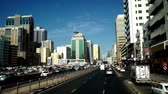 navette : Modern cityscape view by bus in Sharjah, UAE Vidéos Libres De Droits