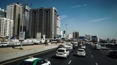 navette : Fast forward of the modern cityscape view by bus in Dubai, UAE
