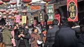 retailers : The customers walking at the Wangfujing Snacks street in Beijing, China. Stock Footage