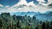 всемирного наследия : Timelapse of the cloud floating over peaks in Zhangjiajie national park, China