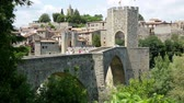 preserved : BESALU, SPAIN - MAY 31, 2015: View of medieval bridge in Besalu. Catalonia
