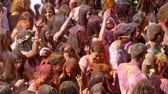 holi : BARCELONA, SPAIN - APRIL 12, 2015: Dirty people at Festival of colours Holy at Barcelona. Holi is traditional holiday of India Stock Footage