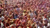 holi : BARCELONA, SPAIN - APRIL 12, 2015: Many happy dirty people at Festival de los colores Holy at Barcelona. It is traditional holiday  of Indian culture