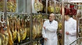 dry cured : Technologist with butcher checking drying wurst and jamon at factory