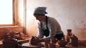 toiler : Smiling female  potter working at workshop Stock Footage