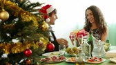 trinta anos : Man giving present to woman during Christmas dinner in home Stock Footage