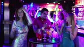 Young students dancing on party with cocktails in the club Stock Footage
