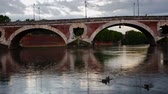 túmulo : View of historic Pont Neuf over Garonne River in Toulouse on rainy spring day Stock Footage