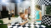 questões : Parents with their children are visiting the escape room stylized under the chessboard. Stock Footage