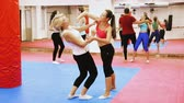 uppercut : Women are doing self-defense in the gym. Stock Footage